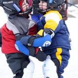 A Twins Kiss and Hug on Ice