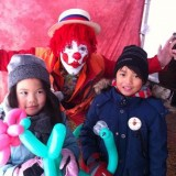 Clown Makes A Snake And A Flower by Jenny C