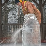 In Motion 3rd Place - Ice Carving Using A Chainsaw by Chuck R