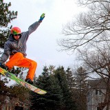 In Motion - Snowboarding at the Carnival by Bud N