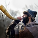 Tradition - Viking man blowing a horn by Edwin H